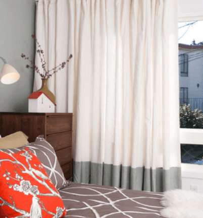 designer two coloured curtains in ecru and charcoal