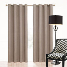 Brown eyelet curtains give a natural earthy feel